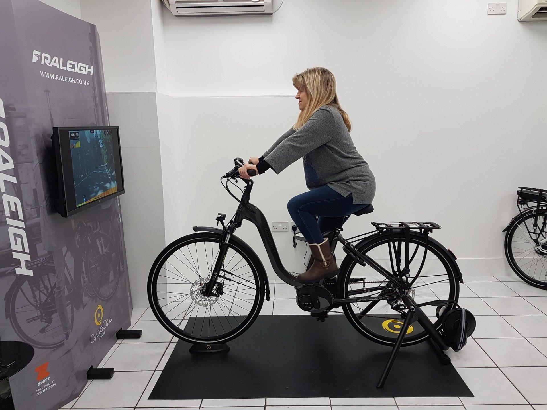 Woman on Raleigh bike simulation